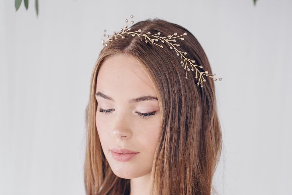 Rosemary gold ribbon tie headband worn as a crown