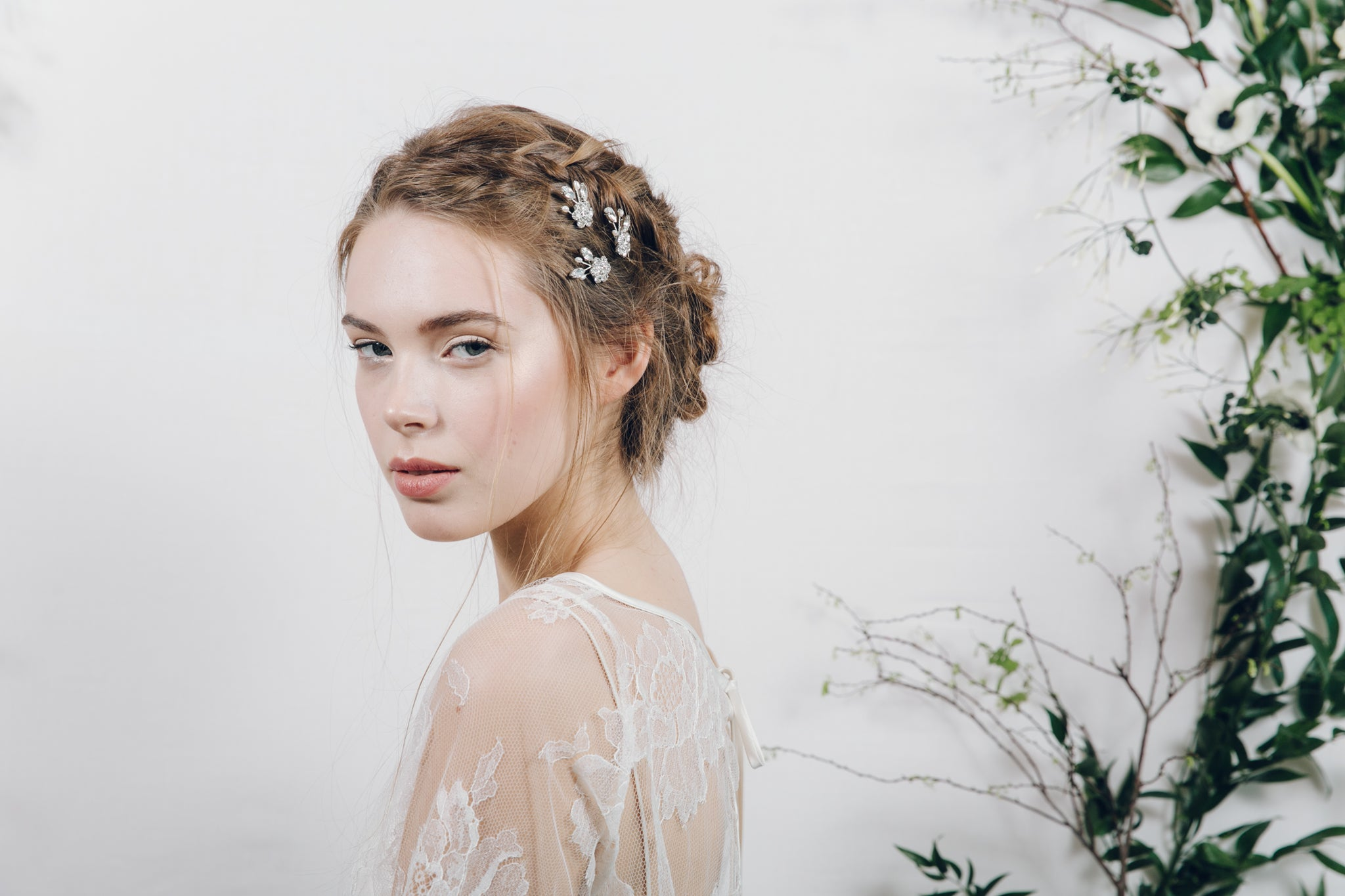 Set of three medium floral wedding hairpins in the side of an updo
