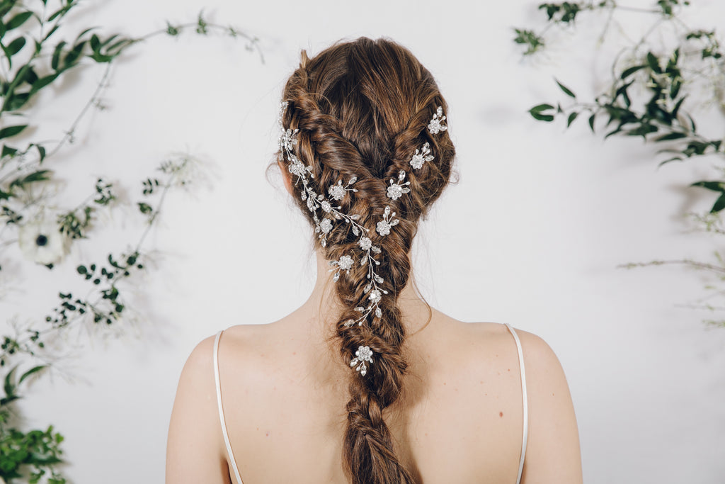 silver crystal hair vine with small flower hair pins in Dutch fishtail braid