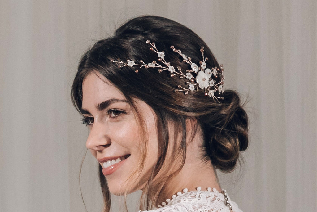 Delicate rose gold side wedding hairvine in soft bridal updo