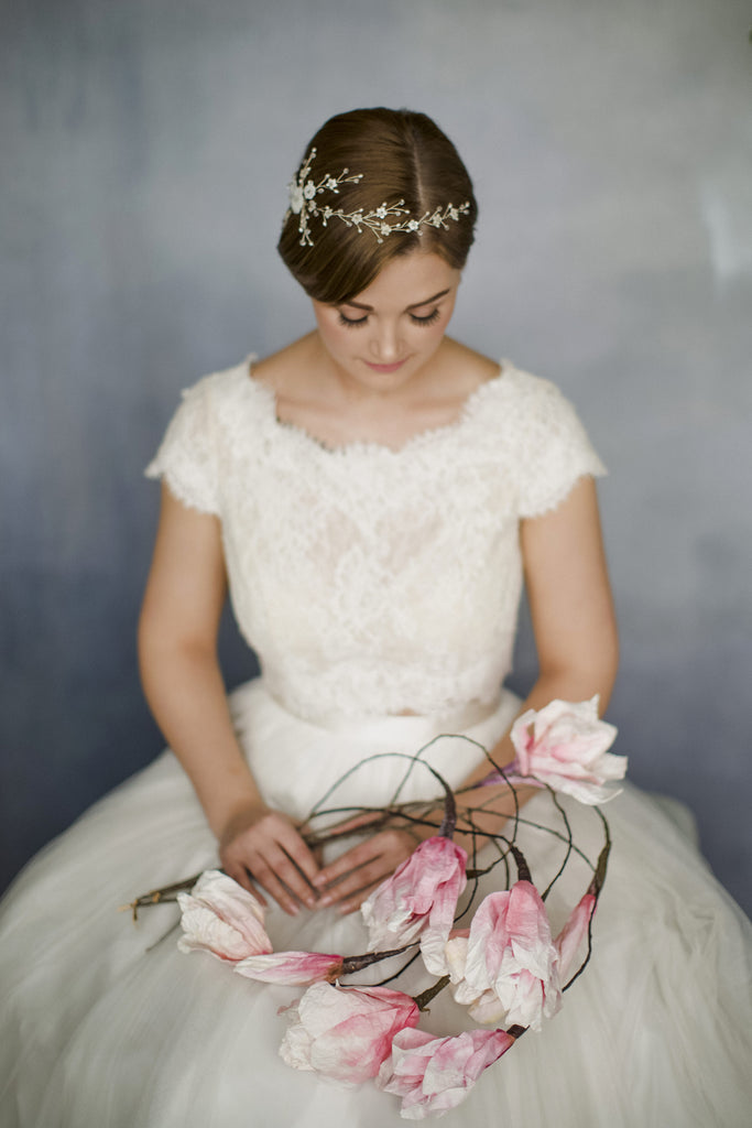 Floral wedding hair vine trailing around short hair for inspiration for short haired brides