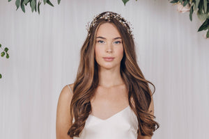 Delicate bridal crown in gold and rose gold