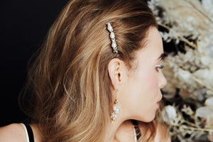 Swarovski star and pearl bridal hair comb worn to the side of the head