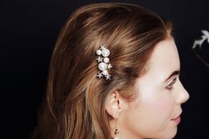 Gold Asteria Swarovski Crystal star and pearl cluster bridal comb worn to side of head