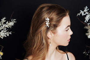 Gold Swarovski Crystal star and pearl cluster bridal hair comb worn to the side of the head