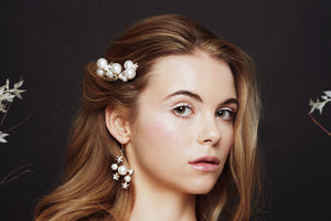 Celestial pearl and crystal star hair pins worn with matching bridal earrings