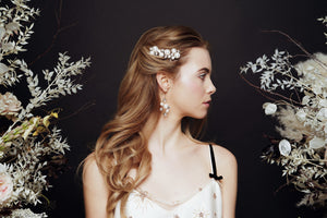 Celestial pearl and crystal star hair pins worn with matching wedding earrings