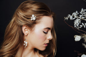 Single Astra crystal and pearl wedding hairpin worn with matching Swarovski Crystal star and pearl bridal earrings