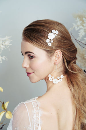 Silver mother of pearl flower comb and matching bridal earrings worn with low ponytail