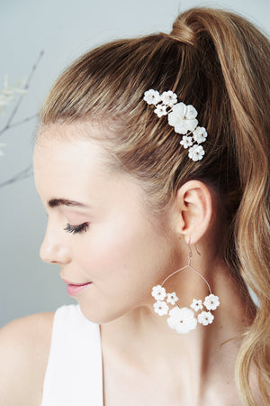 Rose Gold chandelier statement floral mother of pearl bridal earrings worn with matching wedding hair comb