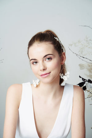 Chandelier mother of pearl flower wedding earrings worn with high ponytail