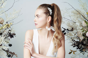 Statement bridal earrings with pearl flowers and matching wedding hair comb