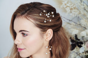 Gold Lunaria Swarovski Crystal star cluster earrings worn with Lunaria hair pins