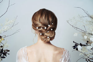 Scattered Swarovski pearl hairpins worn with updo