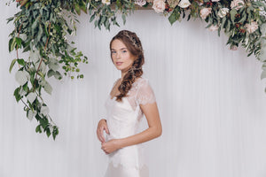 Gold wedding hairvines draped in a bridal braid
