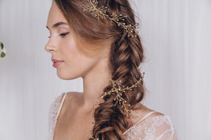 Gold hair vines wrapped around a bridal plait