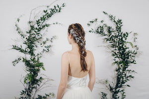 plait with bridal hair pins and hair vine