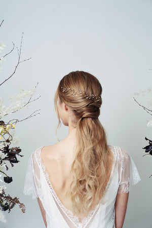 Bohemian leaf hairvine worn with low ponytail half updo