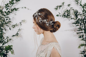 Trailing floral crystal and pearl bridal headpiece