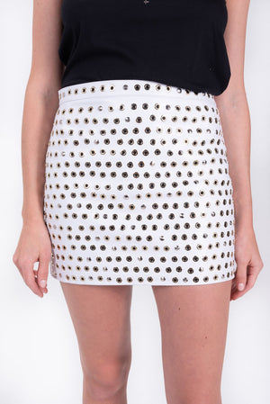 grommet detail studded mini skirt. white leather mini by Nour Hammour