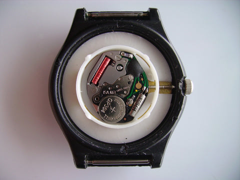 quartz watch with open case back