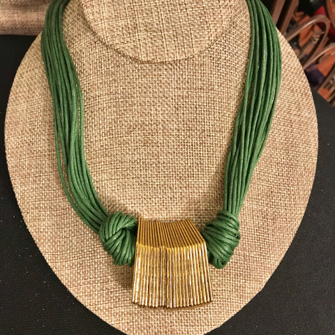 Green multi strand gold metal statement necklace
