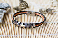 Stainless Steel and Black Leather Bracelet with Copper Tone Steel