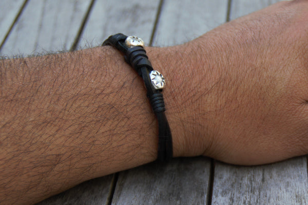 "Silver Stars and Black Leather bracelet on a 8.25"" wrist"