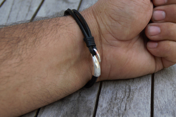 "Silver Stars and Black Leather bracelet on a 8.25"" wrist shows clasp"