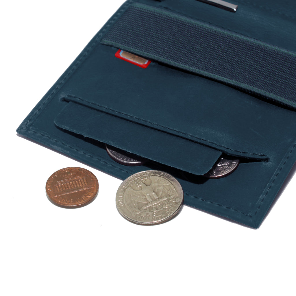 Anti spill compartment of the Aki Bifold wallet in steel blue crazy horse leather stores coins and keys. Also features a designated SIM card slot under the currency band.