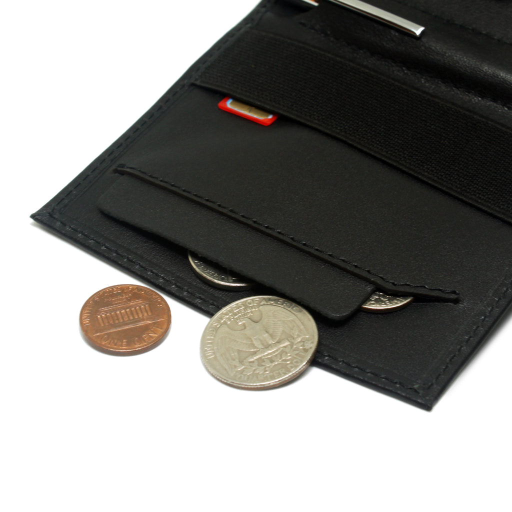 Anti spill compartment of the Aki Bifold wallet in black full grain leather stores coins and keys. Also features a designated SIM card slot under the currency band.