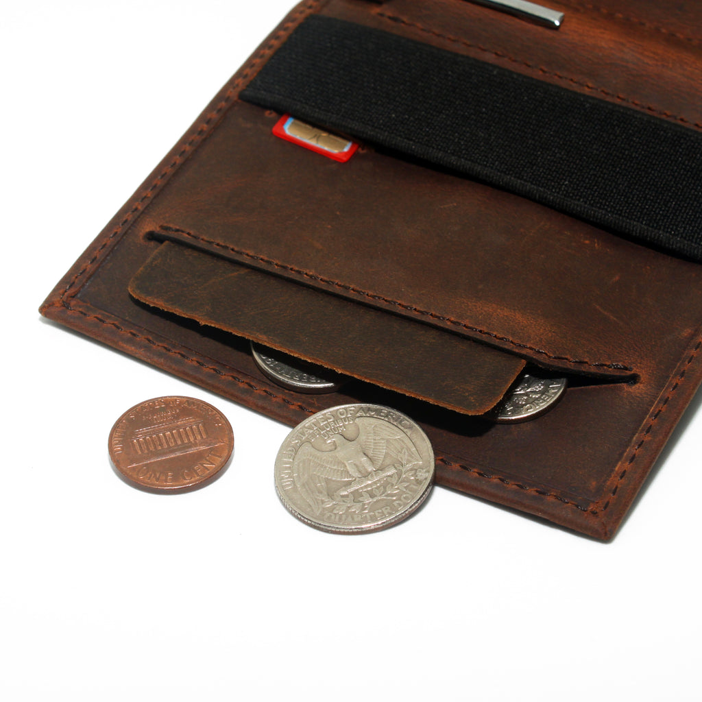 Anti spill compartment of the Aki Bifold wallet in vintage brown crazy horse leather stores coins and keys. Also features a designated SIM card slot under the currency band.