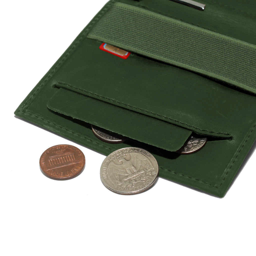 Anti spill compartment of the Aki Bifold wallet in hunter green crazy horse leather stores coins and keys. Also features a designated SIM card slot under the currency band.