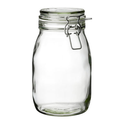 a glass jar filled with water on a table