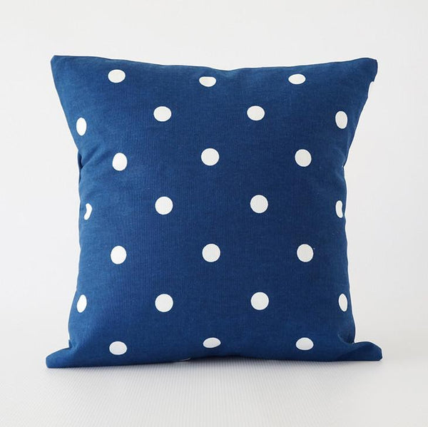 Blue pillow cover with white polka dots