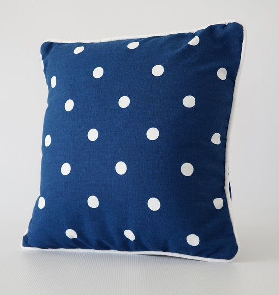 Blue and white polka dot pillow cover with trim