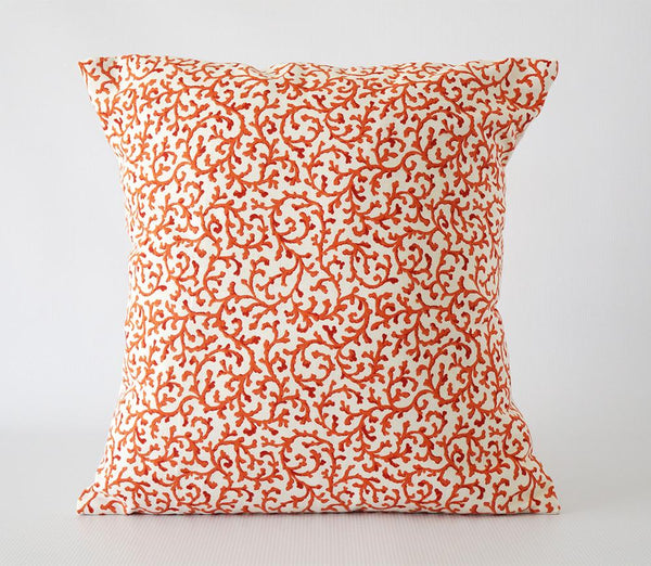 Orange and white pillow cover with coral pattern