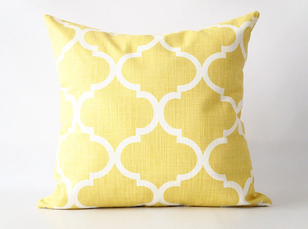 Yellow pillow cover with yellow and white geometric pattern