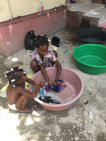 Haitian Girls Washing Clothes