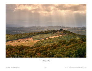 Photo of sun rays hitting farm in Tuscany Italy