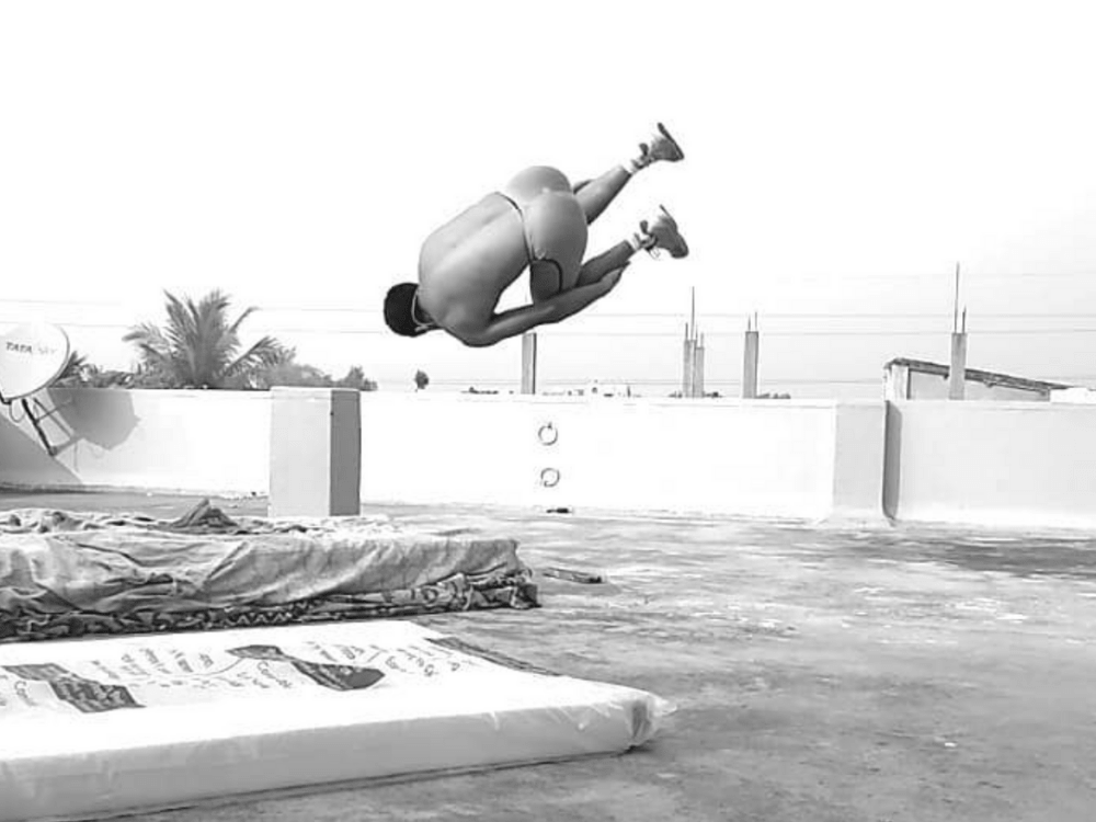 Indian parkour athlete doing front flip in kapow meggings