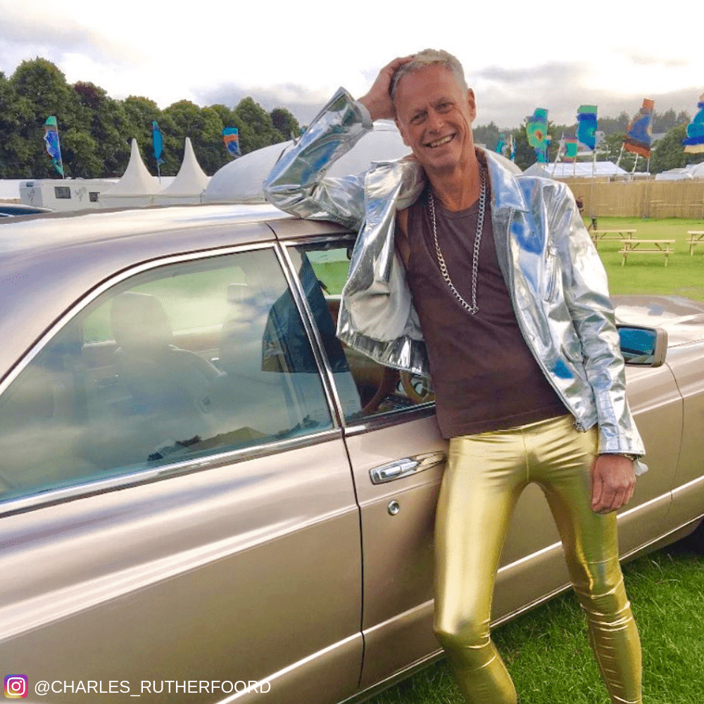 Mens leggings pioneer in gold leggings leaning on car
