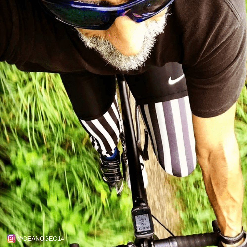 Older man wearing black and white mens tights cycling