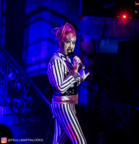 burlesque performer in beetlejuice black and white striped male tights
