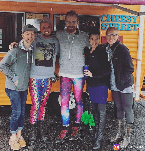 camping festival friends wearing kapow mens leggings to party