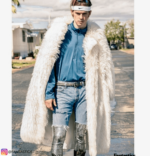 fashion model wearing fur coat silver snakeskin male leggings under denim shorts