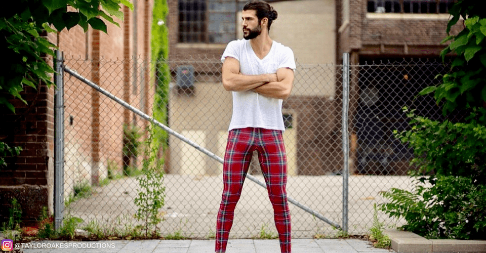 good looking man wearing red tartan male leggings on street