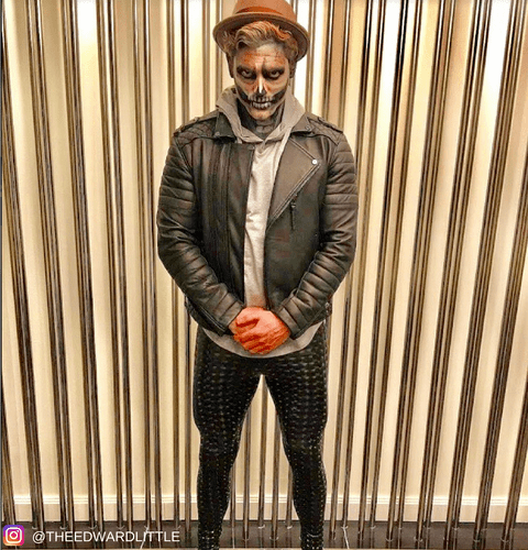 halloween costume guy with skull makeup in black holographic mens leggings