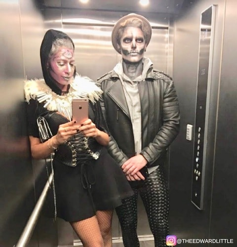 halloween couple in life wearing scary costumes with black holographic male leggings