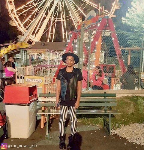 hipster kid at carnival wearing black white striped mens tights